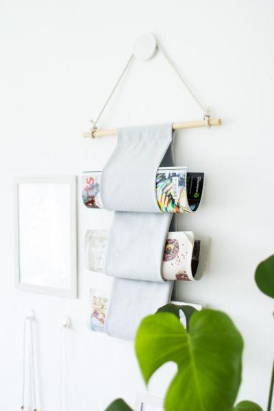 Todos vão te elogiar se você fizer este porta revistas de parede fácil e econômico (Foto: designsponge.com)