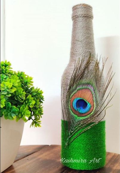 garrafa de vidro decorada com sisal