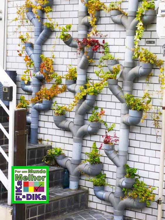 Great Ideas From The Chicago Flower And Garden Show together with Artesanatos Criativos Feitos   Cano Pvc together with How To Build A Hidden Water Fountain additionally House Gate Designs Manufacturer 681105319 together with Hyspec Vct Rubber Ring Joint Concrete Pipes. on pvc pipe vertical garden