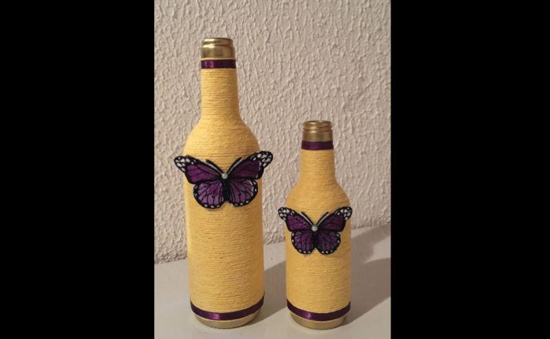 borboleta na garrafa com barbante