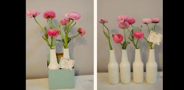 garrafa de vidro com pintura e flor