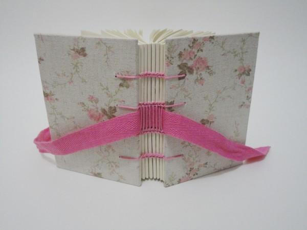encadernação manual rosa