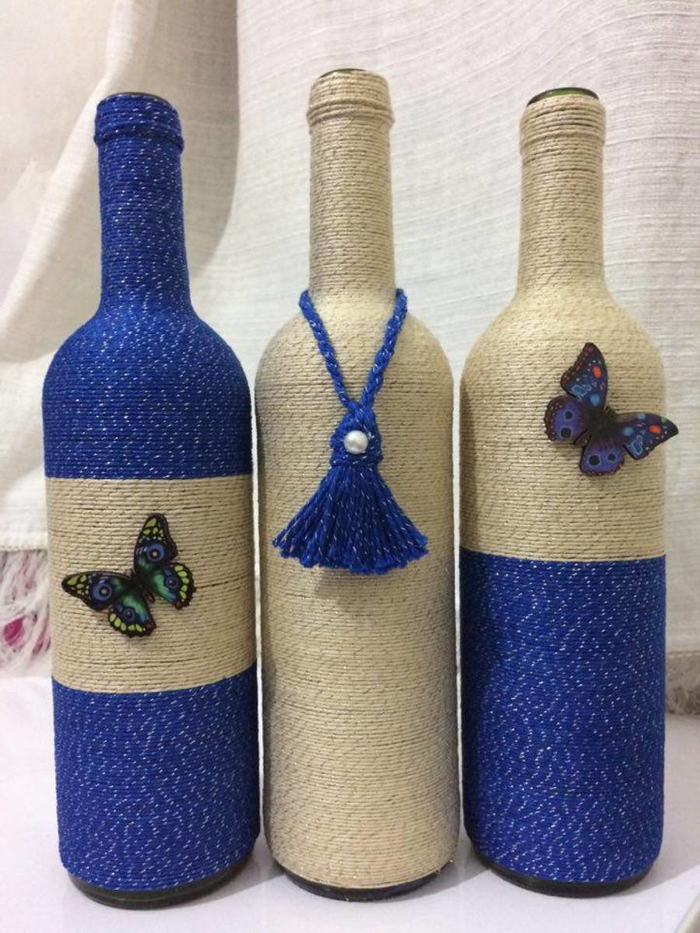 decoração de garrafa com barbante e borboleta