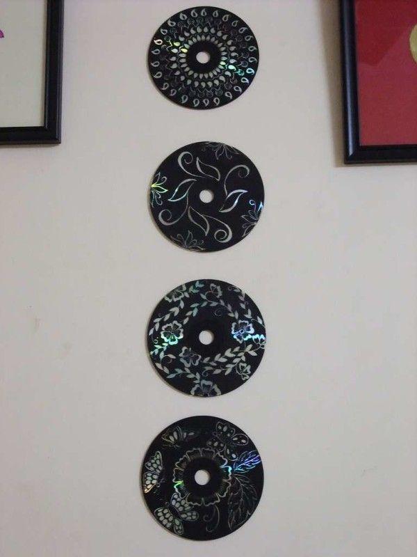 Artesanato com CD antigo na parede