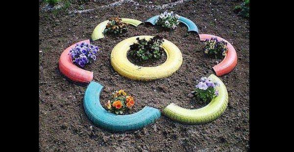 pneus pintados para jardim em flor
