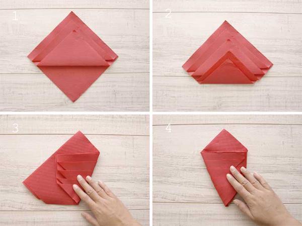 dobradura de guardanapo de papel vermelho