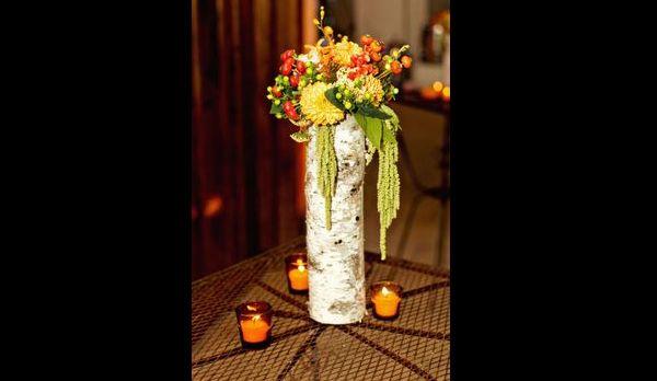 arranjo com flores compridas
