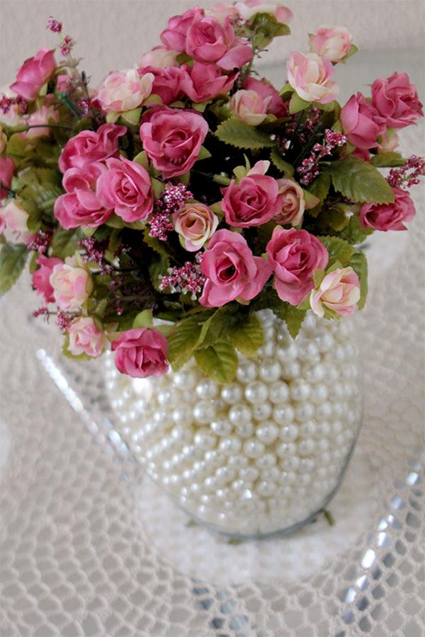 arranjo com flores e perolas