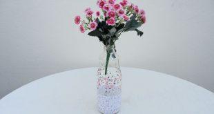 garrafa decorada com flores