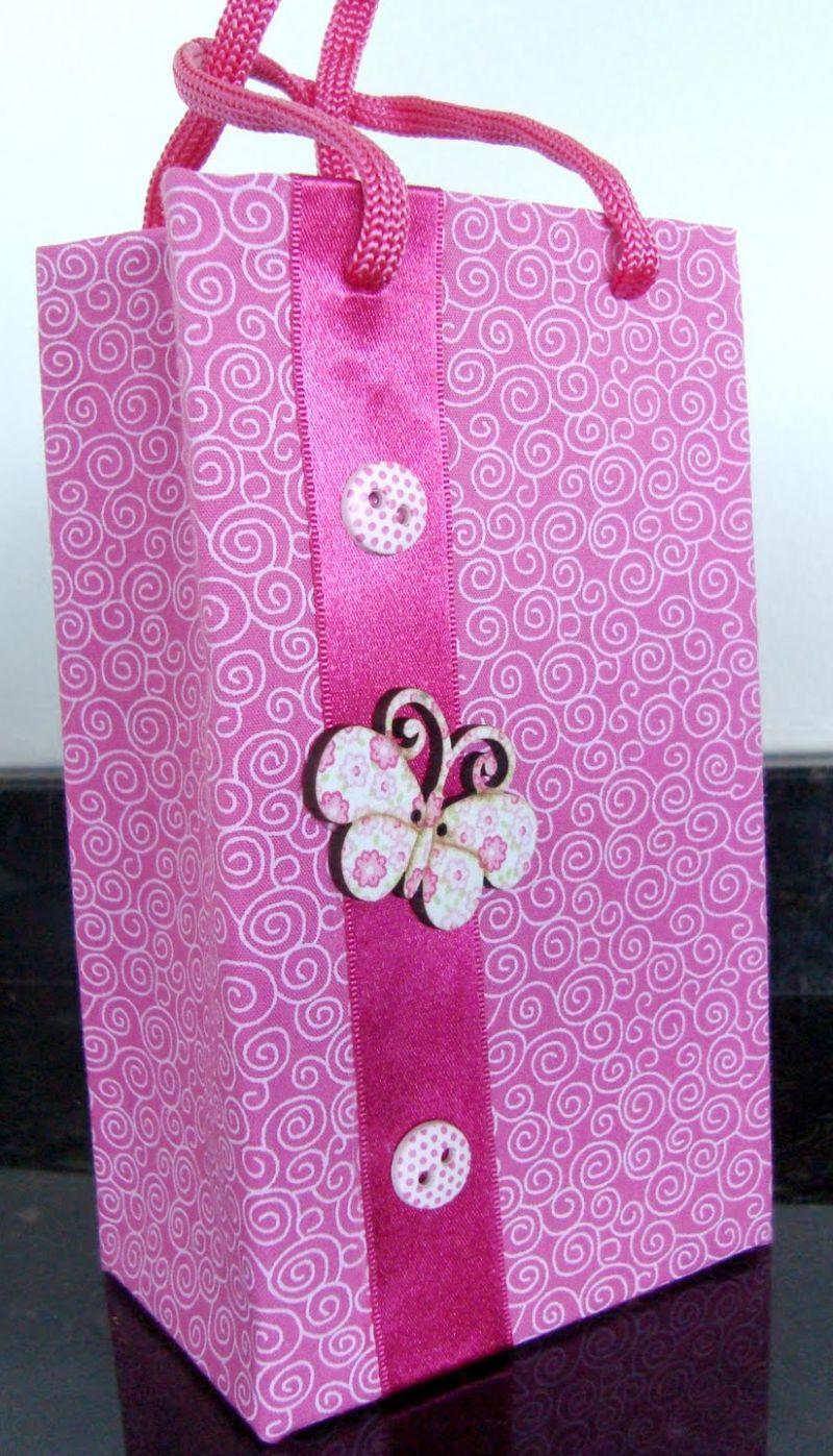 sacolinha de caixa de leite rosa