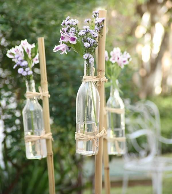 detalhe garrafa de vinho no bambu casamento