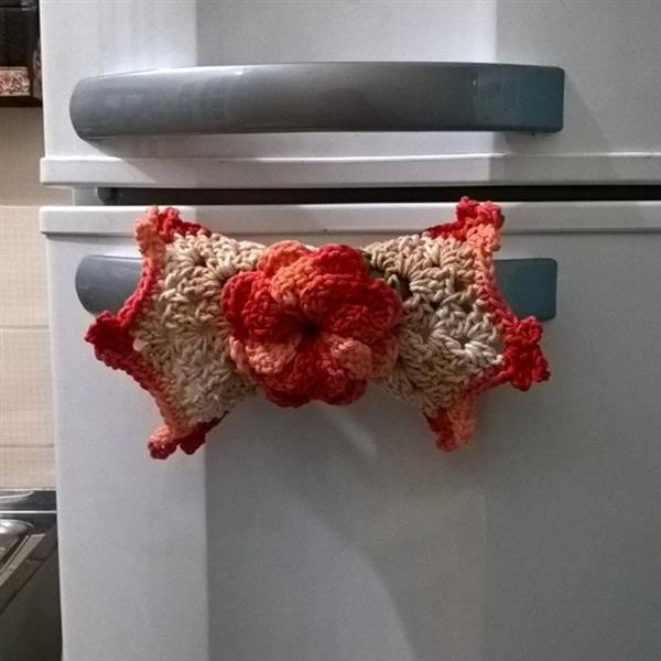 puxador de geladeira de flor