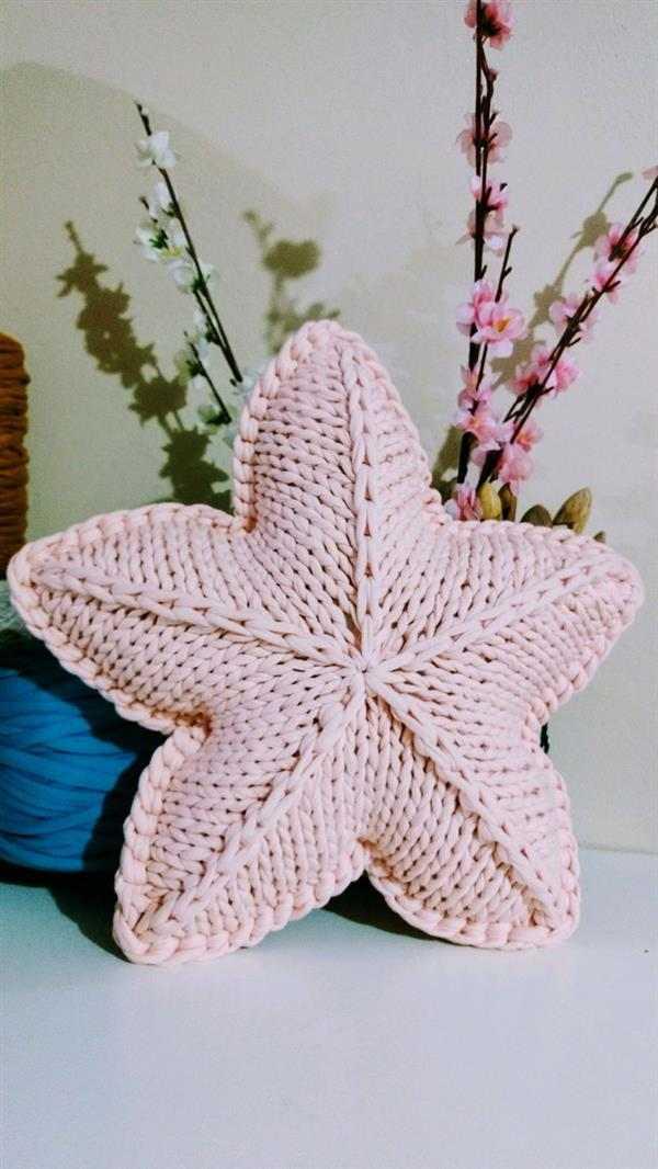 Almofada de tricô estrela