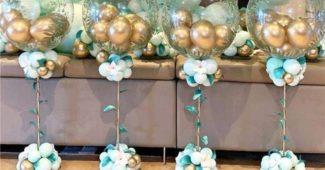 centro de mesa para cha de bebe com balões dourados
