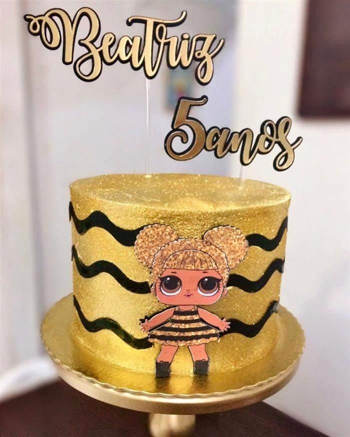 bolo dourado com preto lol