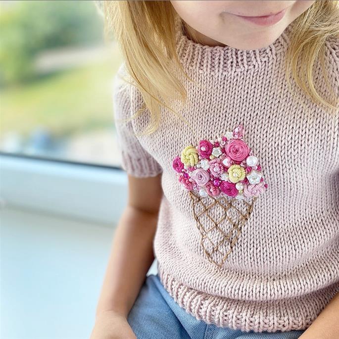 bordado em blusa infantil de trico
