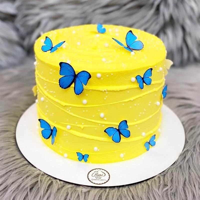 amarelo com borboletas azuis