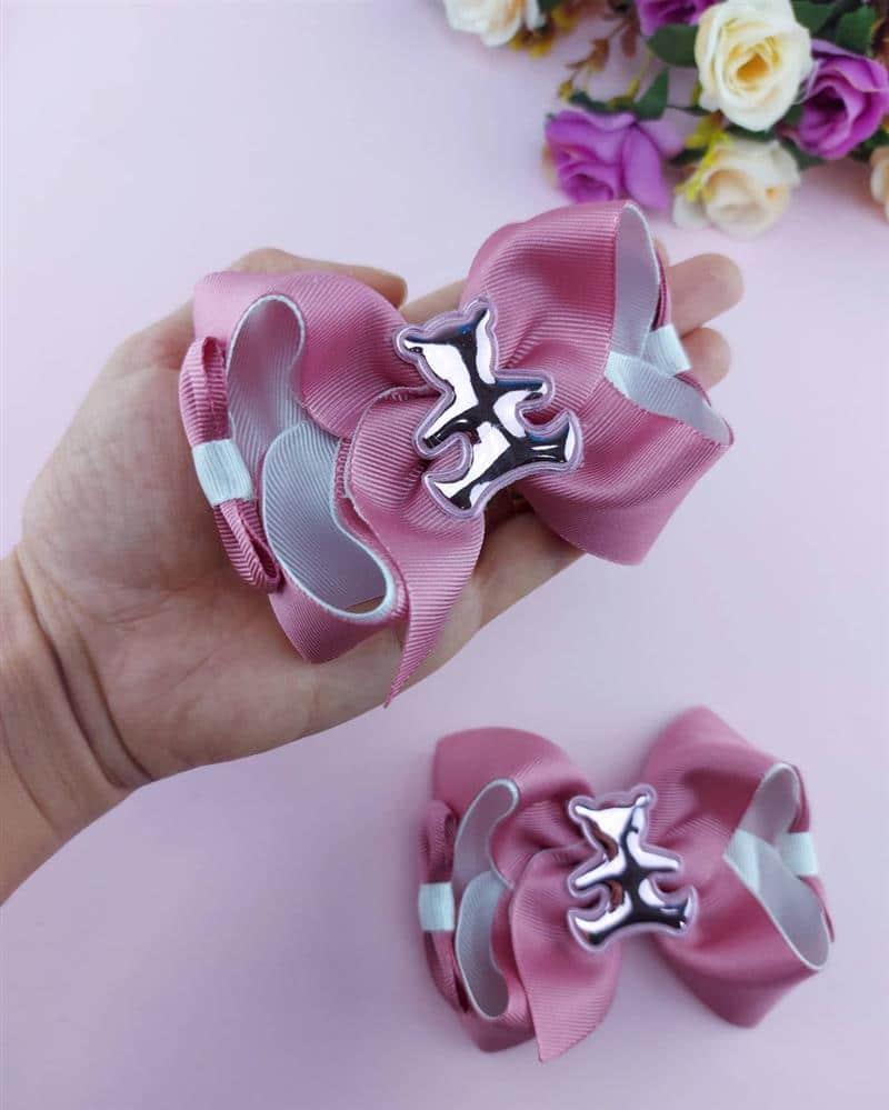 Laço de fita rosa